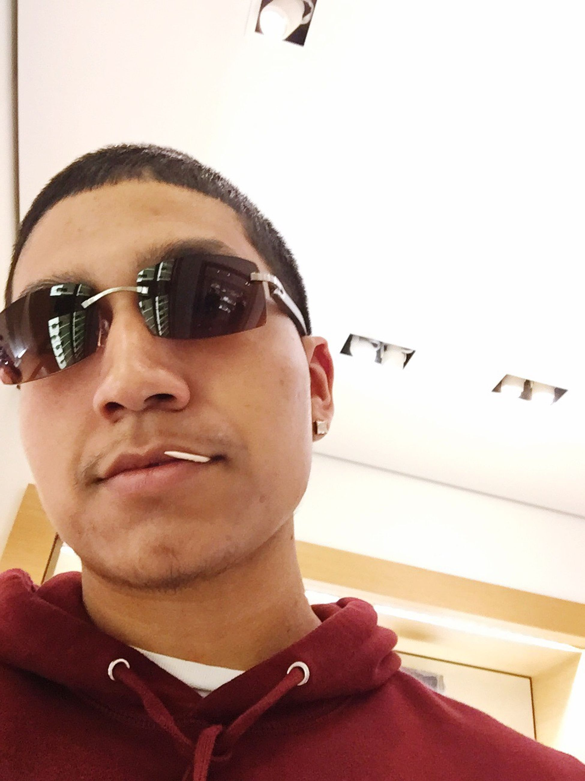 looking at camera, portrait, lifestyles, headshot, young adult, person, young men, indoors, leisure activity, front view, head and shoulders, sunglasses, close-up, smiling, casual clothing, mid adult men, mid adult