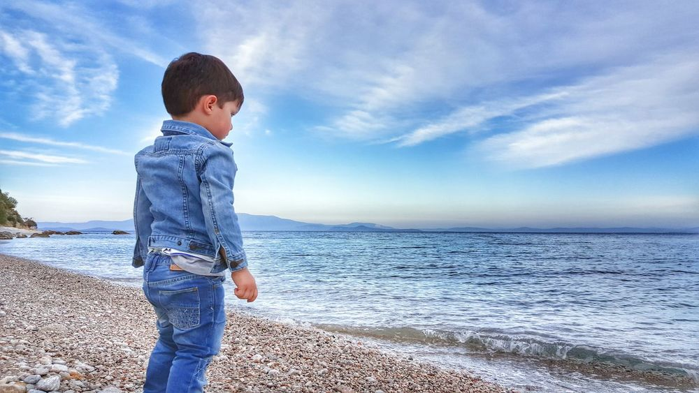 Little Boy Beachphotography Seaside Low Angle View Sea Sky Clouds Blue Wave Children Photography Beauty In Nature Landscape_photography Childsplay Childhood Blue Denim Jacket Bluejeans Landscape_Collection Beach Life On The Beach Blue Sky Seascape Sea And Sky Boy Jeansjacket Jeans Denim The Human Condition