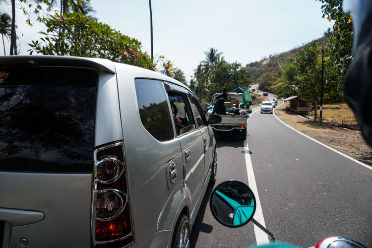 Indonesia, Lombok Island West Nusa Tenggara (NTB), on Sunday (5/8/2018) at around 6:46 p.m., the earthquake with a strength reached 7.0 on the Richter Scale (SR). The photo was taken 3 days after the earthquake along the road to North Lombok which suffered the worst damage. residents make emergency tents along the main road and wait for government assistance and donations from volunteers. the situation in Lombok is still severe, making traffic jams everywhere, scrambling for help to survive. Transportation Land Vehicle Mode Of Transportation Motor Vehicle Car Road Tree Day Plant Street No People City Outdoors Nature Stationary Travel Focus On Foreground Transparent Road Trip Lombok Lombok-Indonesia Lombok Island INDONESIA Earthquake Earthquake Area
