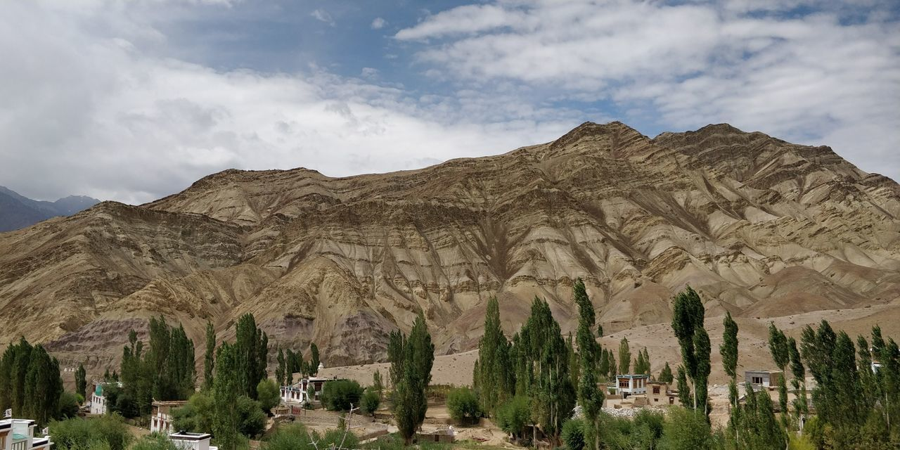 Leh Nature Leh India Sky And Clouds Nature EyeEm Selects Tree Mountain Old Ruin Sky Landscape Cloud - Sky Historic Rocky Mountains Physical Geography Natural Landmark Arid Landscape Natural Arch Rock Formation Arid Climate Civilization