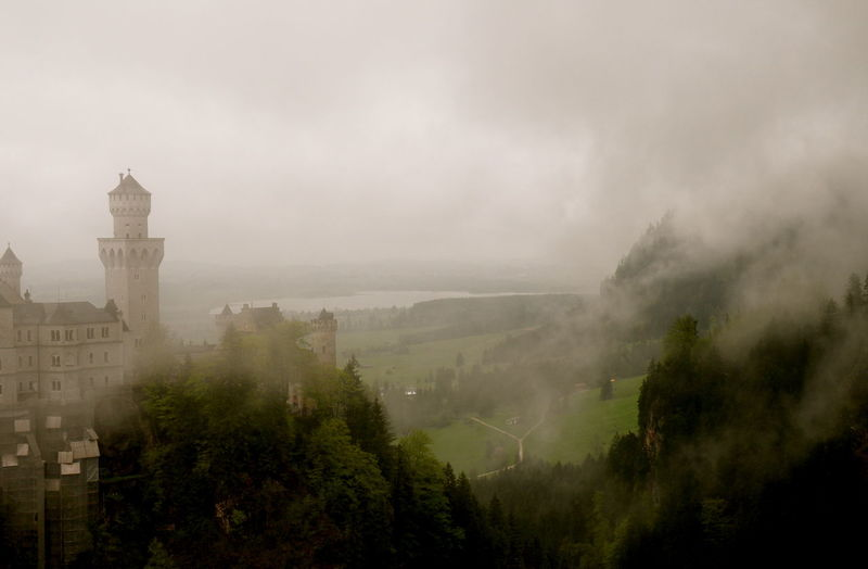 Neuschwanstein castle against sky in foggy weather