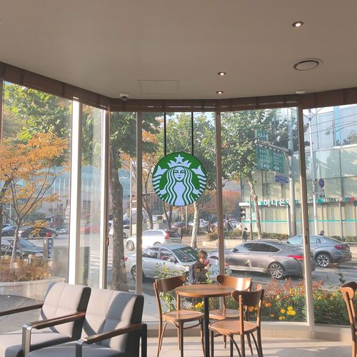 Starbucks Coffee Starbucks Chair Table Architecture Day Built Structure Window Sunlight