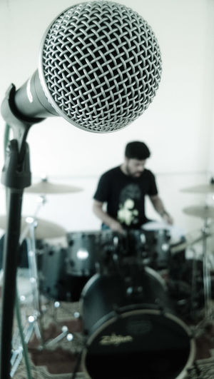 If I cannot fly, let me sing. Band Drummer Drums Focus On Foreground Indoors  Jamming Mapexdrums Mic Microphone Music One Person Passion Rock Band Rock Music Sahastraar Shuremicrophone Singing BYOPaper!
