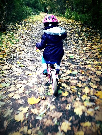 This Is Joy day 6. Chasing Running After Riding A Bike  First Time Leaves In The Woods Sunday Afternoon Nature Outdoors Childhood Sunday Afteroon