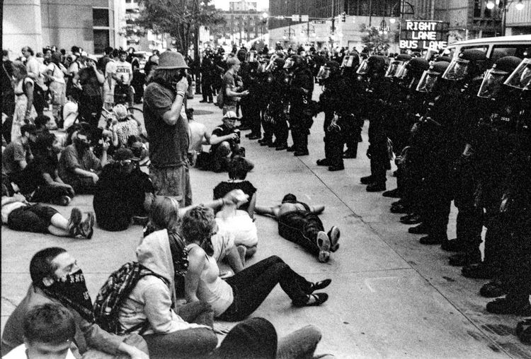 Protests at the 2008 Democratic National Convention (DNC) 2008 Democratic National Convention Black & White Film Protest Adult Adults Only Black And White Black And White Photography Blackandwhite Blackandwhite Photography City Civil Disturbance Crowd Day Film Photography Large Group Of People Men Outdoors People Police Force Police Uniform Protesters Riot Tri-x 400 Pushed