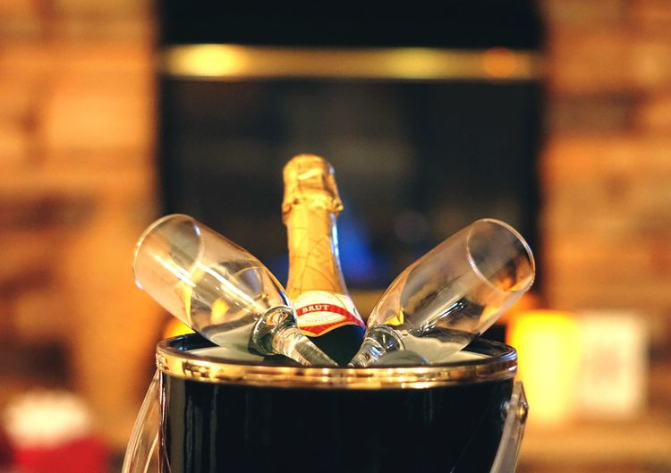 Champagne and champagne flutes chilling in front of the fireplace Holidays Celebration Flûtes Champagne Champagne EyeEm Selects Focus On Foreground Close-up No People Indoors  Container Still Life Drink Glass - Material Bottle Shiny Selective Focus