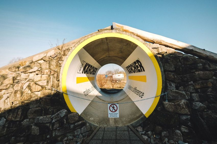 Tunnel Open Edit EyeEm Best Edits Circle Tunnel Geometric Shapes Symmetry Symmetrical Direction Better Look Twice Truck No People Built Structure Yellow Cylinder Hole Loop Vanishing Point Canon 70d Arch Sign Forbidden Showcase: February Outdoors Circles In Circles Geometry