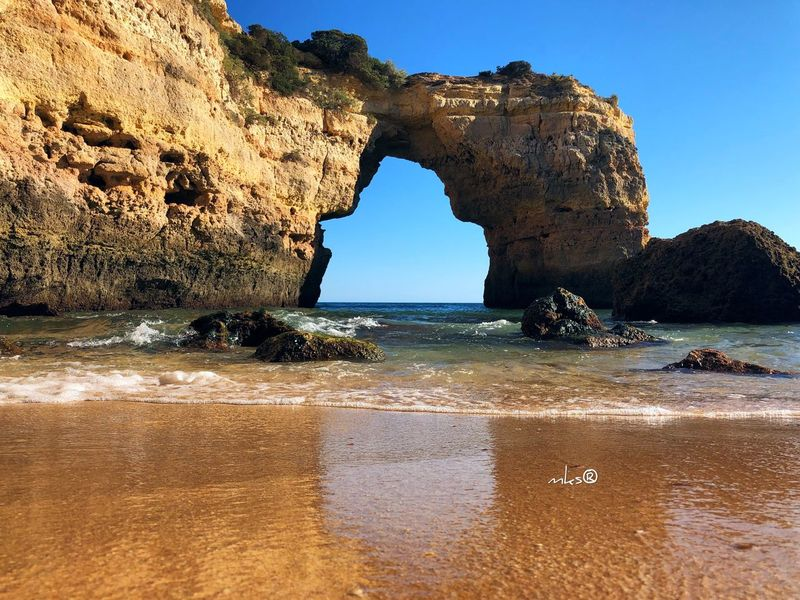Door of the freedom Beach Landscape Travel Destinations Bestoftheday EyeEm Best Shots Photography Algarve Water Sea Land Sky Rock Beach Nature Rock - Object Natural Arch Beauty In Nature Tranquility Scenics - Nature Sunlight Sand