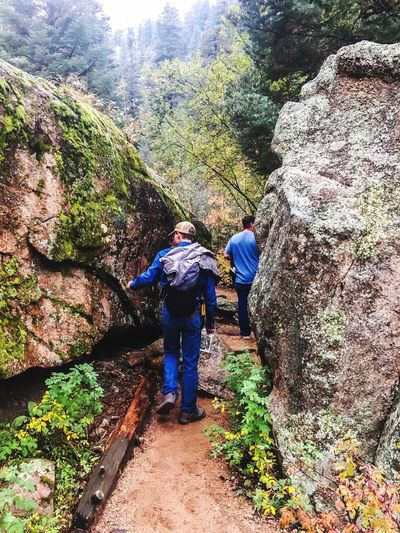Two People Real People Rock - Object Hiking Full Length Rear View Leisure Activity Adventure Walking Mountain Nature Lifestyles Men Beauty In Nature Backpack Day Togetherness Hiker Outdoors Casual Clothing