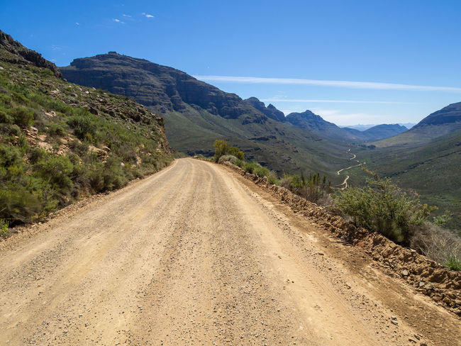 Dirt road and landscape in Cederberg Wilderness Mountain Area, South Africa Cederberg South Africa Beauty In Nature Cedarberg Day Dirt Road Landscape Mountain Mountain Range Nature No People Outdoors Road Scenics Sky The Way Forward Tranquil Scene Tranquility Transportation Tree Winding Road