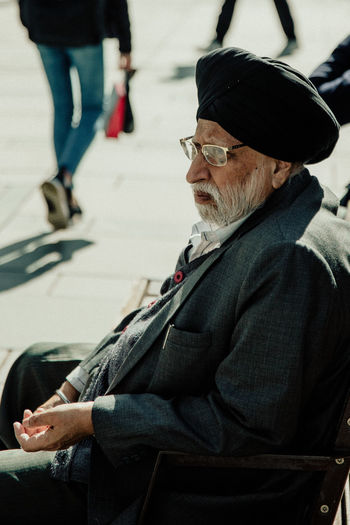 Streetwise Photography Vienna Streetphotography Men Real People Glasses Sitting Senior Adult Males  Senior Men Adult Side View One Person Incidental People Focus On Foreground Lifestyles Casual Clothing Eyeglasses  Leisure Activity Day Clothing Transportation Wien The Art Of Street Photography The Street Photographer - 2019 EyeEm Awards