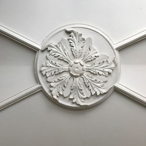 Ornament on a ceiling with plasterwork Cieling Classic Medaillon Ornament Architecture Ceiling Art Close-up Day Indoors  No People Plasterwork Upwards Shot