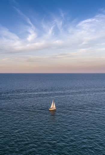Sailing on Lake Michigan Water Nautical Vessel Sea Sky Sailboat Sailing Transportation Mode Of Transportation Cloud - Sky Sailing Ship Travel Ship Horizon Over Water Scenics - Nature Luxury Blue Nature Beauty In Nature Horizon Yachting Yacht No People Freedom Outdoors Recreational Boat