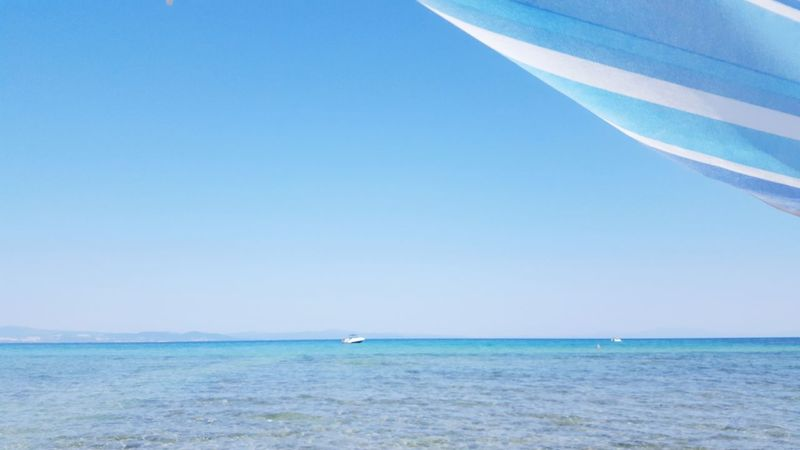 blue sea in an area in greece halkidiki Summer Relaxation Quiet Peaceful Tranquil Greece Holidays Outdoors Summetime Halkidiki Yachting Water Clear Sky Sea Wave Sailing Beach Blue Seascape Ocean Coastal Feature Coast Turquoise Colored Wake - Water Island Low Tide Calm