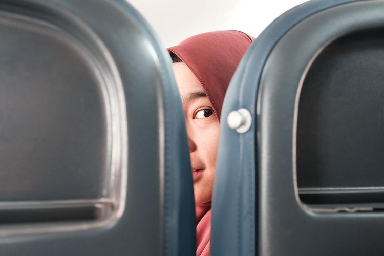 Portrait of man seen through airplane