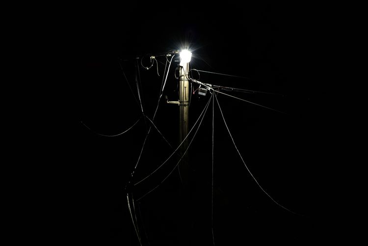 Night Illuminated Electricity  Studio Shot Low Angle View Cable Black Background Technology No People Outdoors Close-up