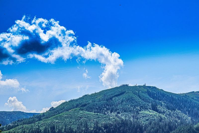 Blue Nature Beauty In Nature Sky Scenics - Nature No People Day Mountain Outdoors Low Angle View Land Cloud - Sky Power In Nature