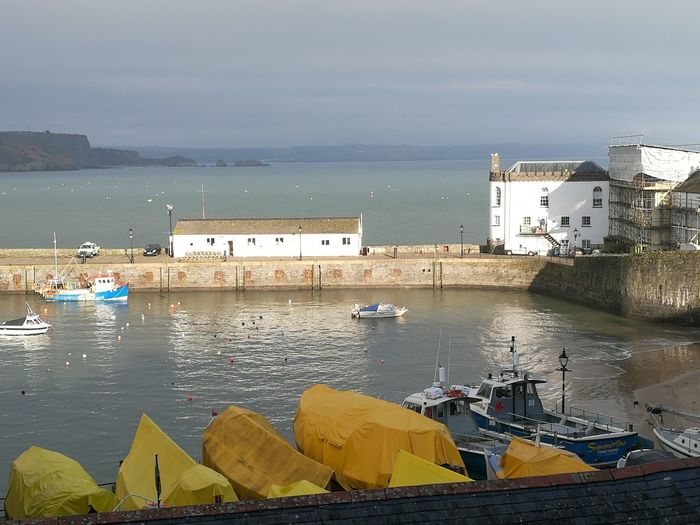 Winter sun breaking through Nofilter Boats⛵️ Yellow Sea Waterfront Reflections Pembrokeshire Coast Pembrokeshire Coastal Path Light And Shadow Beach Sea Harbor Tranquility Building Exterior Water Travel Destinations