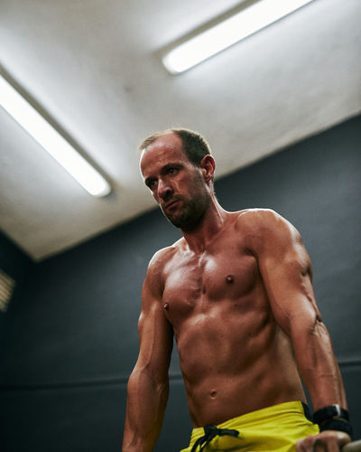 Portrait of shirtless man standing