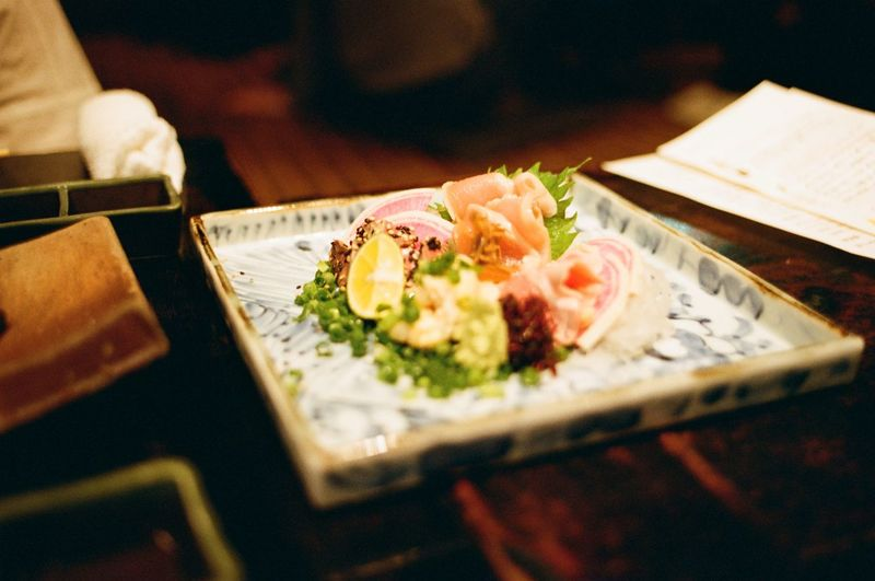 High angle view of sashimi served in plate on table