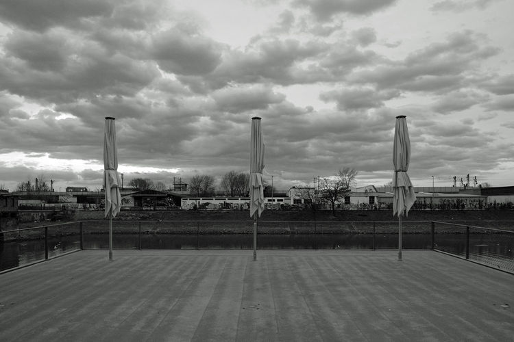 Urd, Verdandi, Skuld Architecture Blackandwhite Canal Cloud - Sky Dark Day Empty Jungbusch Mannheim No People Outdoors Sky Symmetry Three Umbrella