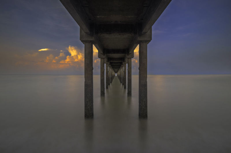 Scenic View Of Pier Over Sea Against Sky During Sunset