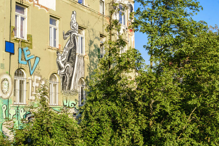 Close up view of a building from Karl-Heine-Straße, Leipzig, Germany. Graffiti Travel Trees Architecture Building Exterior Built Structure Close-up Day Graffiti Art Graffiti Building Graffiti Wall Green Color House Low Angle View No People Outdoors Plant Travel Destinations Tree