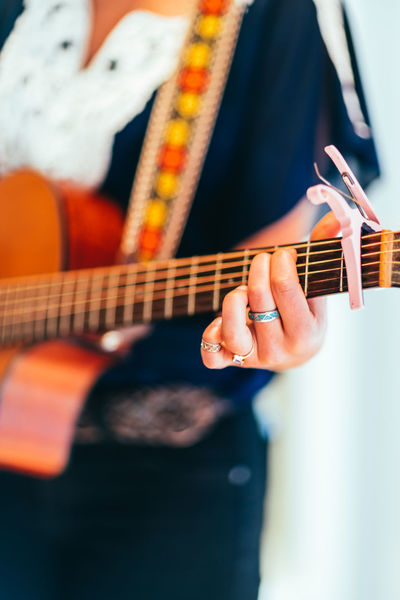 Guitar Lessons Lessons Music Entertainment Entertainment Event Guitar Guitar Hand Guitar Performance Guitar Tutor Guitarist Hand Guitar Instrument Learn Guitar Learn Music Music Lessons Music Tutor Musical Instrument Musician Performance Play String Instrument Strum Woman Guitar