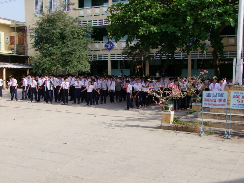 School Children Exercising Building Exterior City Life Composition Culture Day Exercising Full Frame Fun Hoi An Large Group Of People Leisure Activity Lifestyles Mixed Age Range Outdoor Photography Outdoors School School Children School Playground Traditional Trees Uniforms Vietnam