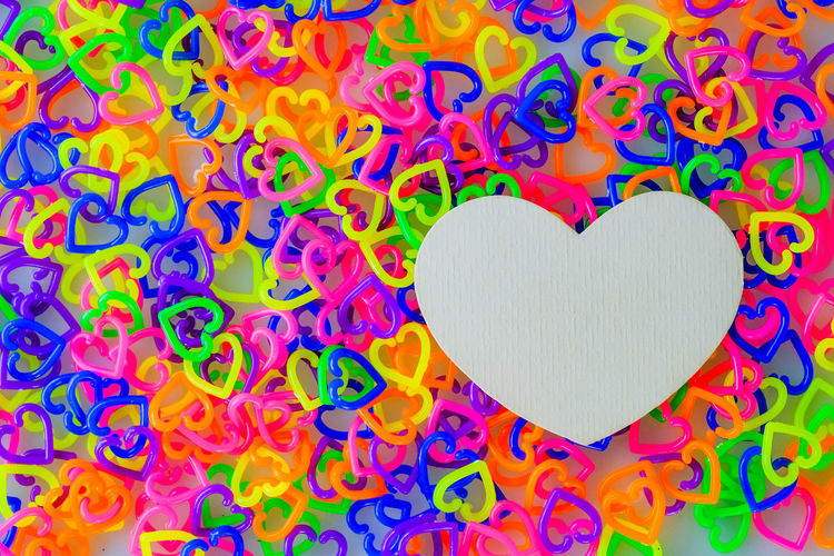 Close-up of heart shape made on multi colored paper