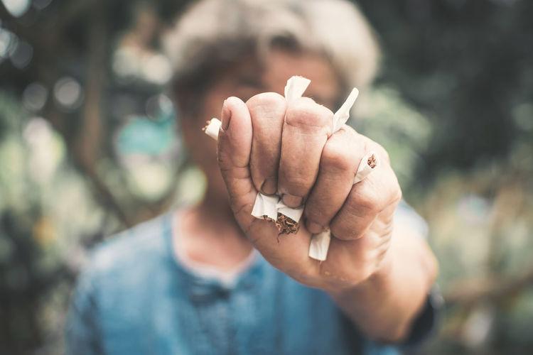 Woman Crushing Cigarette