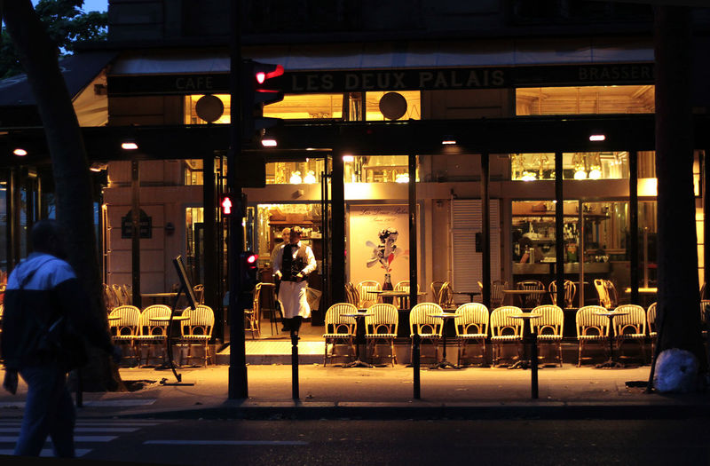 a restaurant in Paris City Cities at Night City Street Illuminated Lifestyles Travel Destinations