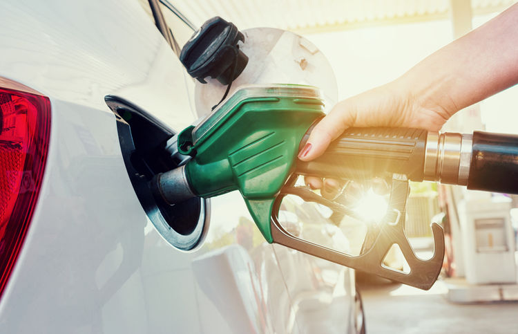 refueling gas on a gas station Bio Car Close-up Day Filling Fossil Fuel Fuel And Power Generation Fuel Pump Gas Pump Gas Station Gasoline Holding Human Body Part Human Hand Land Vehicle Men Mode Of Transport Oil Industry One Person Outdoors People Refueling Sunlight Transportation Woman