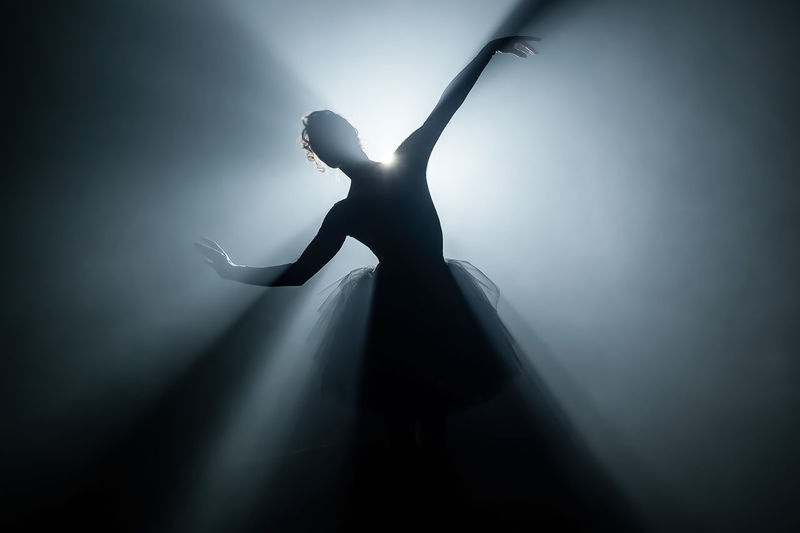 Silhouette ballet dancer dancing on stage