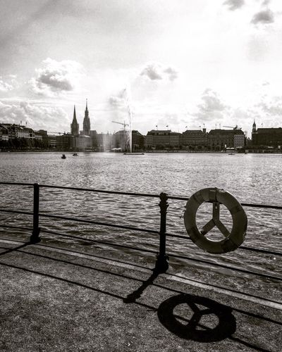 Water Sky Built Structure Outdoors Day No People City Hamburg Alster Railing Light And Shadow Shadow Cityscape Black And White Bnw Blackandwhite Photography Black & White City Travel Destinations Travel Monochrome Street Photography Tourism Springtime