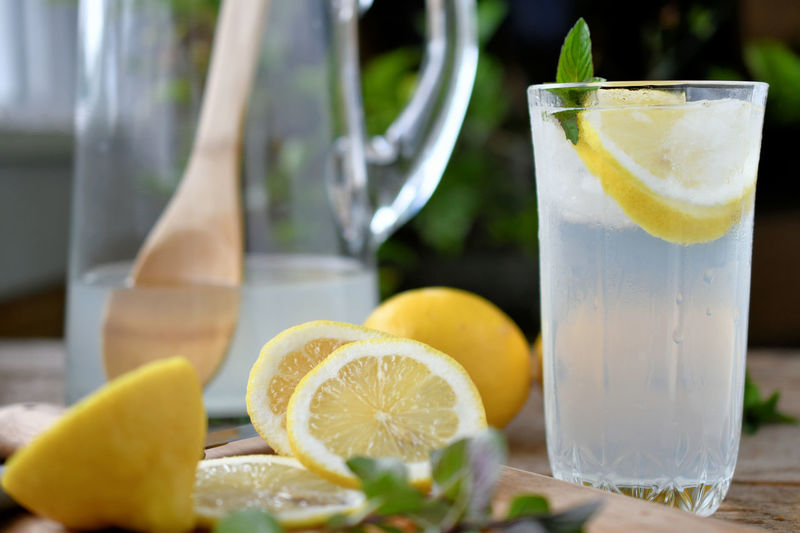 Close-up of lemonade on wooden table