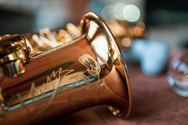 Close-up of alto saxophone on table