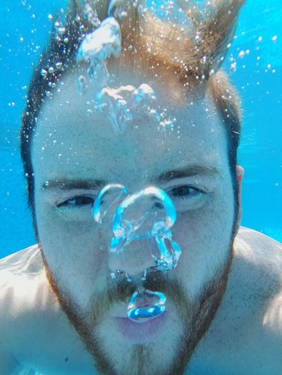 Bubble One Person Water Front View Portrait Underwater Looking At Camera Adults Only People Only Men Human Face Human Body Part Close-up Headshot Blue One Man Only Adult Young Adult UnderSea Day