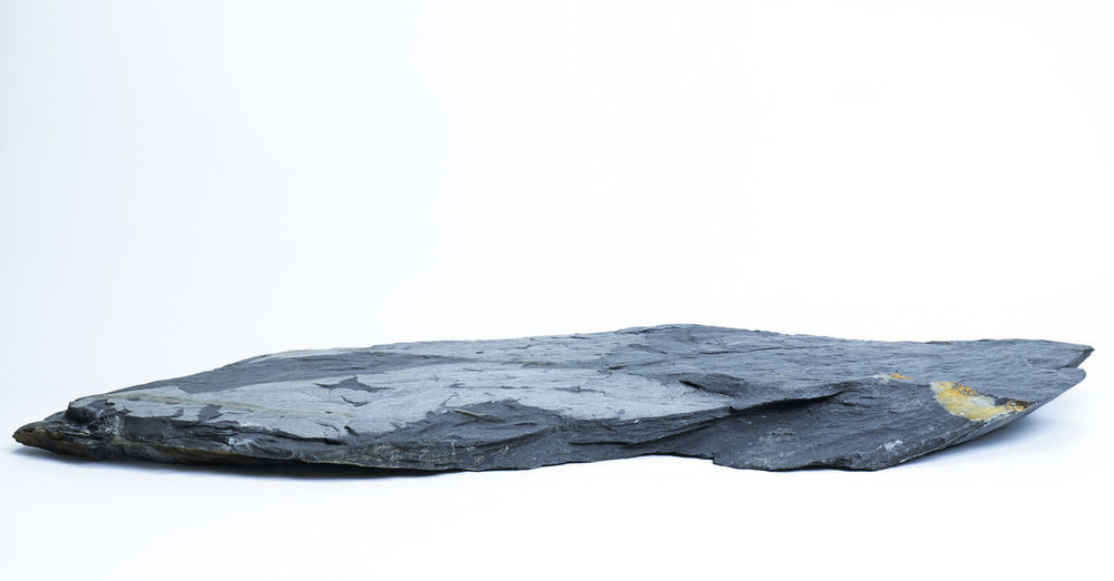 Close-up of rocks against white background