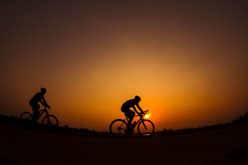 cyclist Adult Adventure Beauty In Nature Bicycle Biker Bmx Cycling Cycling Full Length Headwear Land Vehicle Leisure Activity Men Mode Of Transport Mountain Bike Nature One Person Outdoors Real People Riding Silhouette Sky Sport Sunset Transportation Travel