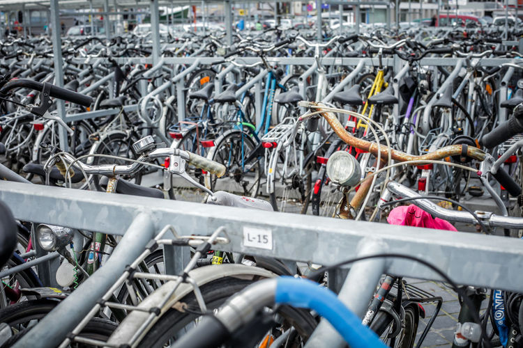 bike park Abundance Bicycle Bycicle Car Day High Angle View In A Row Land Vehicle Large Group Of Objects Lock Metal Mode Of Transport Padlock Parked Parking Parking Lot Protection Safety Stationary Street Transportation CyclingUnites