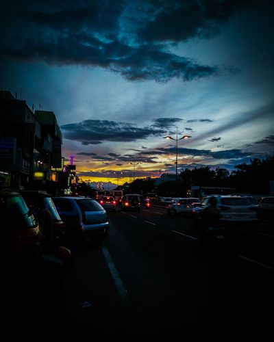 Car Transportation Land Vehicle Mode Of Transport Road Illuminated Sunset Traffic Parking Cloud - Sky Sky City Cloud Dramatic Sky Outdoors The Way Forward Stationary Blue Cloudy Rush Hour