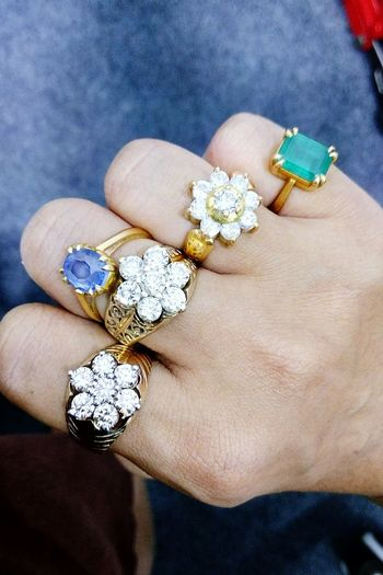 Close-up of hand with various rings