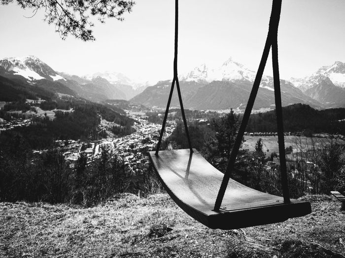 Mountainrange Snowcapped Mountain Landscape Tree Mountain Rope Swing Swing Hanging Sky Outdoor Play Equipment Calm Countryside Mountain Range Snowcapped Snow Covered Jungle Gym Playground Pine Tree Pine Woodland