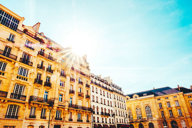 Architecture Blue Sky Building Exterior Buildings Buildings & Sky Built Structure City Day Low Angle Shot Low Angle View No People Outdoors Paris Sky Streetlife Streetphotography Sun Sunflare Sunrays Wide Angle Window