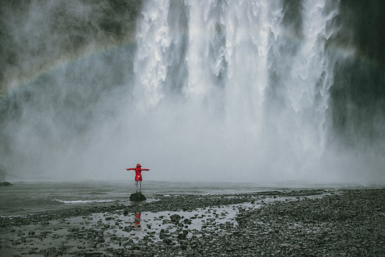 Exploring Iceland Nature Travel Wanderlust Woman Arms Outstretched Beauty In Nature Beauty In Nature Cold Temperature Day Full Length Motion Nature Outdoors Power In Nature Rainbow Scenics Spraying Tranquility Travel Destinations Water Waterfall Weather Winter