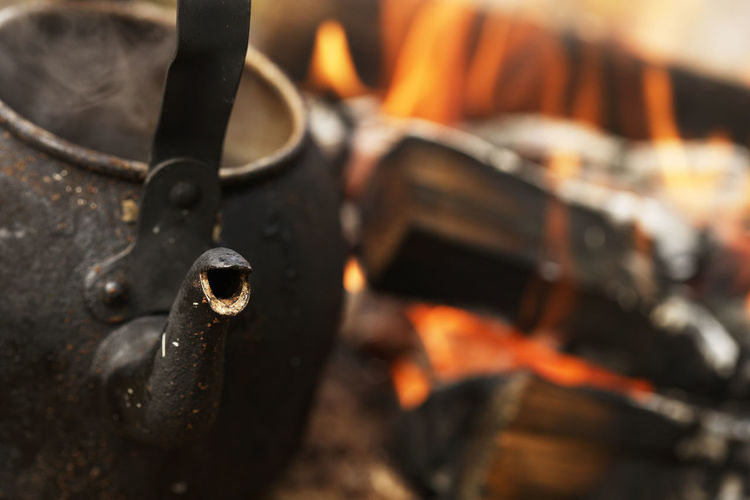 Close-up of kettle on campfire