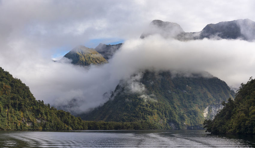 Doubtful Sound New Zealand captured during changing weather and breaking of the inversion cloud layers Water Beauty In Nature Scenics - Nature Sky Mountain Nature Tranquility Tranquil Scene Cloud - Sky Day No People New Zealand Doubtful Sound Landscape Tourism Travel Destinations New Zealand Scenery Fiordland Milford Sound Fjord Cruise Tasman Sea High Resolution