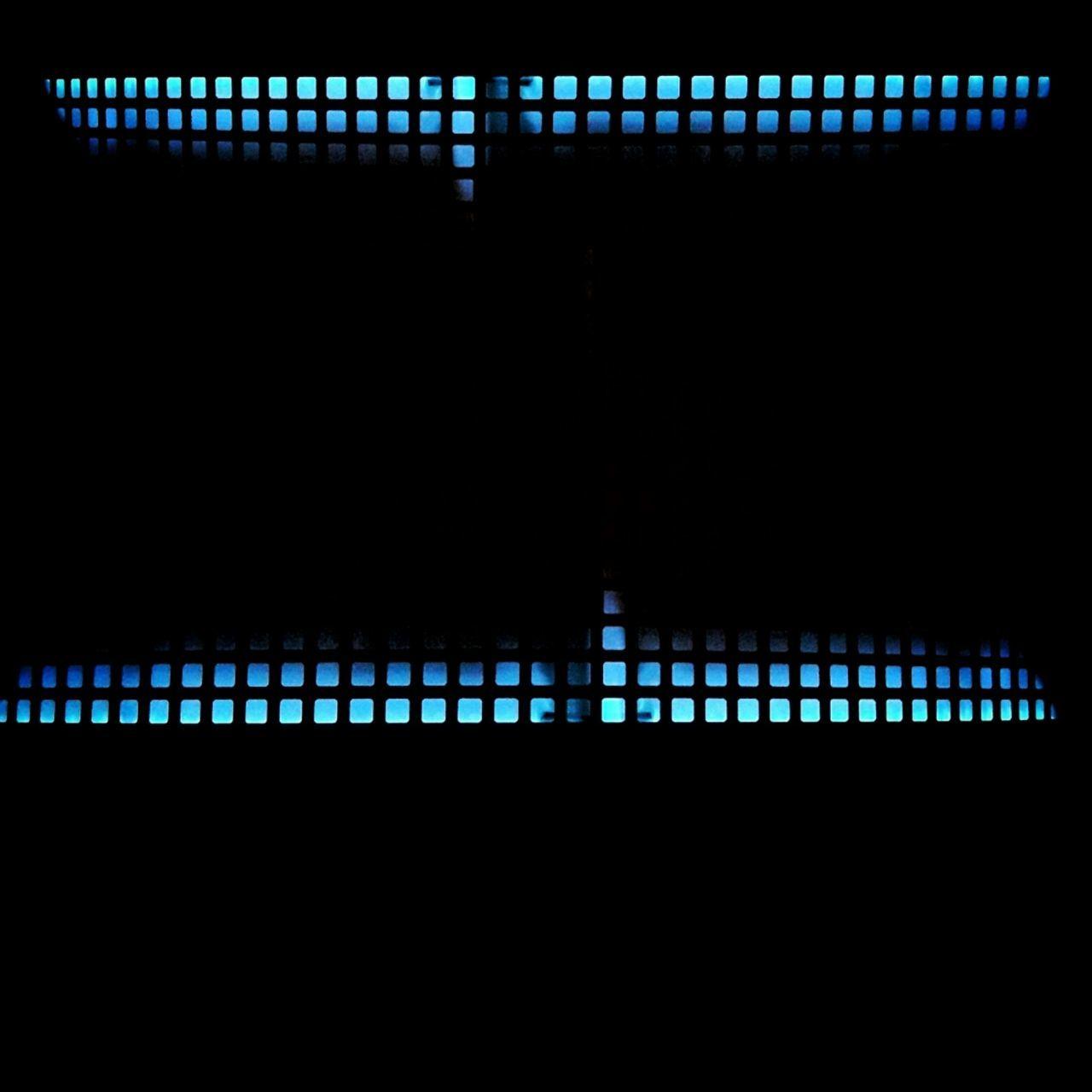 ILLUMINATED LIGHT BULBS AT NIGHT