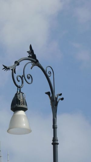 Low angle view of vintage street light against sky